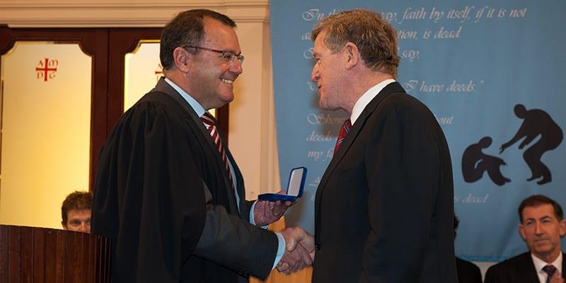 Professor Tony Costello receiving the Xaverian Award