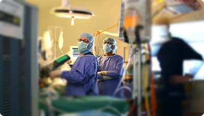 Surgeons on a Operation Room Ready to Operate